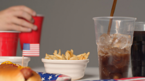 Sliding-Shot-Approaching-Bowl-of-Fries-and-Cola-Being-Poured-into-Cup