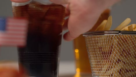 Sliding-Shot-Approaching-Bowl-of-Fries-and-Soda-as-Hand-Takes-Soda-Away