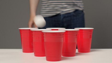 Sliding-Shot-Approaching-Plastic-Cups-as-Person-In-Background-Plays-Beer-Pong
