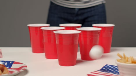 Sliding-Shot-Approaching-Plastic-Cups-as-a-Person-In-Background-Plays-Beer-Pong