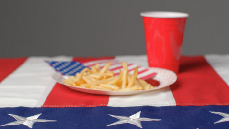 Sliding-Shot-Approaching-Plate-of-Fries-with-Red-Plastic-Beer-Cup