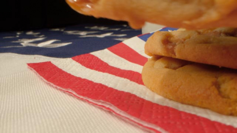 Sliding-Shot-Past-Cookies-and-a-Glass-of-Milk-On-American-Flag