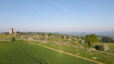 Drone-Shot-Flying-Low-Over-Cotswold-Hills-Near-Broadway-Tower