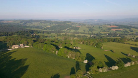 Drone-Shot-Flying-High-Over-Rolling-Cotswold-Hills
