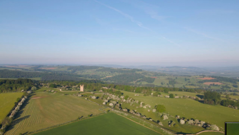 Drone-Shot-Flying-High-Over-Rolling-Cotswold-Hills-Near-the-Broadway-Tower