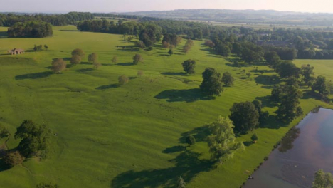 Drone-Shot-Flying-Over-Small-Rural-Body-of-Water