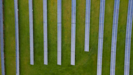Drone-Shot-Looking-Down-On-a-Rural-Solar-Field-