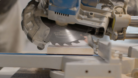 Close-Up-Shot-of-Circular-Saw-Being-Lined-Up-On-Skirting-Board