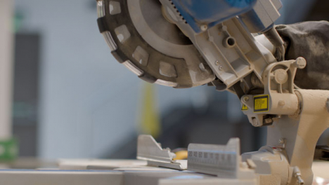 Handheld-Shot-of-Circular-Saw-Covered-In-Saw-Dust