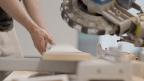 Pull-Focus-Shot-from-Carpenters-Hands-to-Circular-Saw