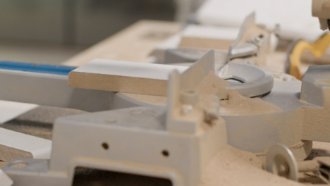 Close-Up-Shot-of-Circular-Saw-Base-Covered-In-Saw-Dust