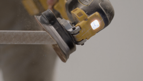 Extreme-Close-Up-Shot-of-Sander-Being-Used-On-Skirting-Board