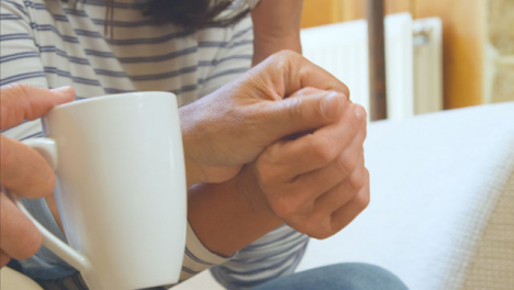 Close-Up-Shot-of-Middle-Aged-Couples-Hands-as-Husband-Tries-to-Comfort-Upset-Wife