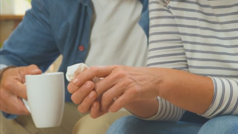 Close-Up-Shot-of-a-Middle-Aged-Couples-Hands-as-Husband-Tries-to-Comfort-Upset-Wife