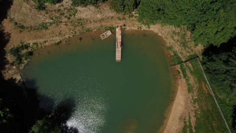 Drone-Shot-Looking-Down-On-Jetty-as-It-Ascends-Above-Scenic-Lake-Part-1-of-2