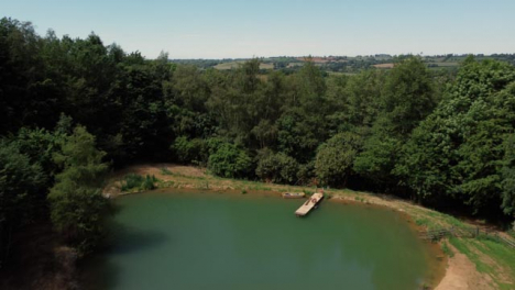 Drone-Shot-Flying-Low-Over-Trees-to-Reveal-Scenic-Lake-Part-1-of-2