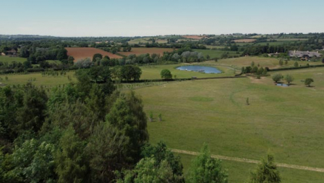 Drone-Shot-Flying-Low-Over-Trees-to-Reveal-Scenic-Lake-Part-2-of-2