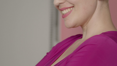 Close-Up-Shot-of-Female-Model-s-Mouth-as-She-Smiles-During-