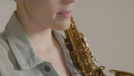 Close-Up-Shot-of-Model-Posing-with-Saxophone