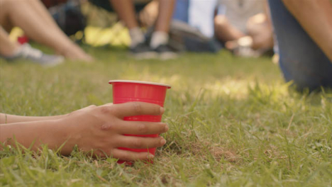 Close-Up-Shot-of-Festival-Goer-s-Hand-Holding-Plastic-Beer-Cup