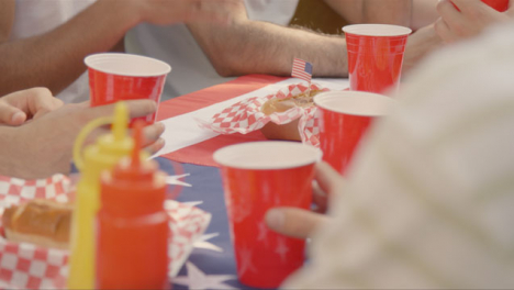 Over-the-Shoulder-Shot-of-Beer-Cups-On-Table-