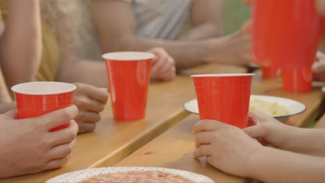 Close-Up-Shot-of-Red-Beer-Cups-Sitting-On-Table-