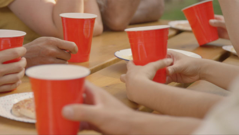 Close-Up-Shot-of-Red-Beer-Cups-Sitting-On-a-Table-