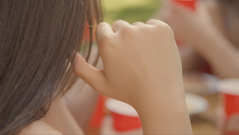 Close-Up-Shot-of-Young-Woman-s-Head-Resting-Head-Against-Her-Hand