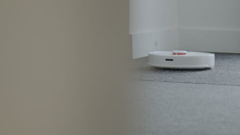 Long-Shot-of-Robotic-Vacuum-Cleaner-Cleaning-a-Carpet