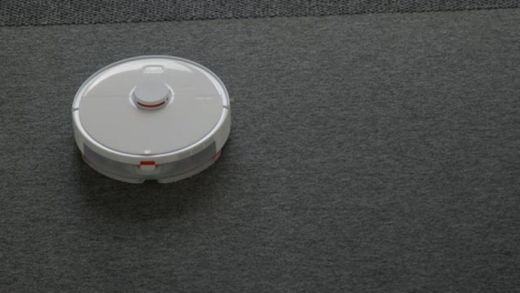 High-Angle-Shot-of-Robotic-Vacuum-Cleaner-Cleaning-Carpet