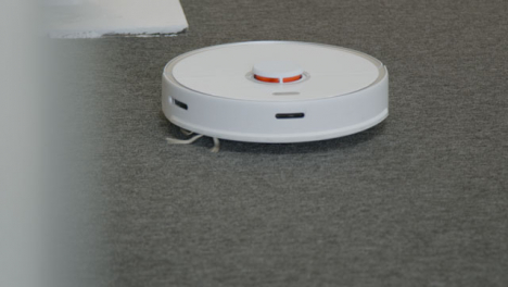 Long-Shot-of-Automatic-Robotic-Vacuum-Cleaner-Cleaning-a-Carpet