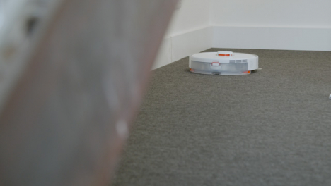 Long-Shot-of-an-Automatic-Robotic-Vacuum-Cleaner-Cleaning-Carpet