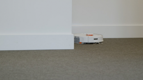 Long-Shot-of-an-Automatic-Robotic-Vacuum-Cleaner-Cleaning-a-Carpet