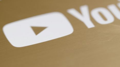 Extreme-Close-Up-Shot-of-YouTube-1-000-000-Subscriber-Plaque-Rotating-