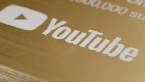 Extreme-Close-Up-Shot-of-YouTube-1-000-000-Subscriber-Milestone-Plaque-Rotating-