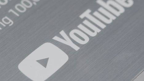 Extreme-Close-Up-Shot-of-a-YouTube-100-000-Subscriber-Milestone-Plaque-Rotating