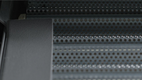 Extreme-Close-Up-Shot-of-a-Metal-Roller-Shutter-Opening-Part-1-of-2