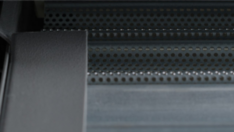 Extreme-Close-Up-Shot-of-a-Metal-Roller-Shutter-Opening-Part-2-of-2