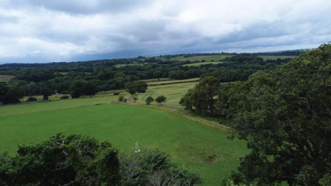 Drone-Shot-Flying-Over-Trees-and-Countryside-Hills-Part-1-of-2