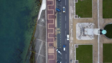 Drone-Shot-Looking-Down-on-Coastal-Road-and-Footpath