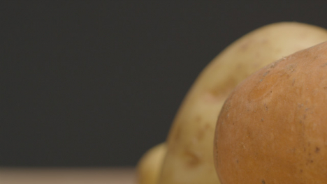 Sliding-Extreme-Close-Up-Shot-of-a-Pile-of-Assorted-Potatoes