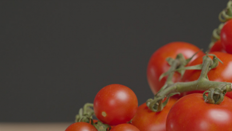 Sliding-Extreme-Close-Up-Shot-of-a-Pile-of-Tomatoes-