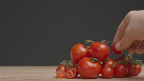 Medium-Shot-of-Pile-of-Tomatoes-as-Hand-Placing-One-On-Pile