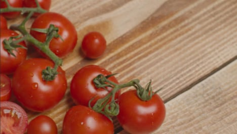 Close-Up-Shot-Panning-Over-Tomatoes-On-Rustic-Wooden-Table-