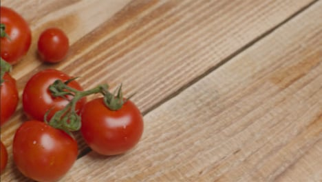 Close-Up-Shot-Panning-Over-Tomatoes-On-a-Rustic-Wooden-Table-