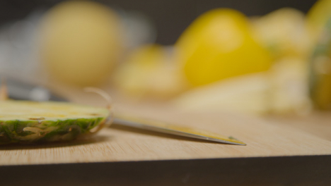 Close-Up-Shot-of-Kitchen-Knife-On-Chopping-Board
