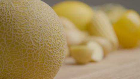 Close-Up-Shot-of-Melon-On-Rustic-Wood-Table