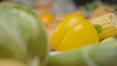 Close-Up-Shot-of-Yellow-Pepper-Amongst-Assorted-Vegetables-