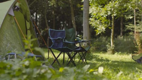 Long-Shot-of-Camping-Chairs-Next-to-Tents
