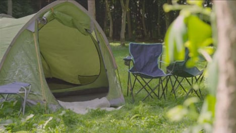 Medium-Shot-of-Camping-Chairs-Sat-Next-to-Tent